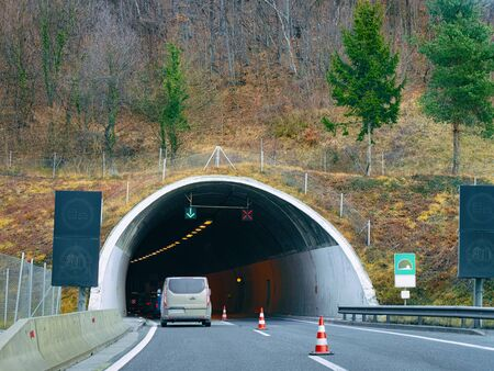 Car in the road driving from the tunnel in the mountains in Slovenia. Travel in Europe Imagens - 129812814