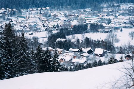 Scenery and snowy winter landscape in Bad Goisern village near Hallstatt in Upper Austria. Forest and trees with snow view. Austrian landmark.