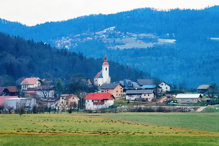 Panoramic view with Landscape and Old town in Austria in Europe. Small village in Austrian Alps. Building architecture and church. Road scenery