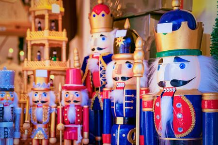 Wooden Christmas toys and decorations at Christmas market at Germany in Europe in winter. German street Xmas fair with wood nutcrackers in European city or town. Berlin on Alexanderplatz Stock Photo