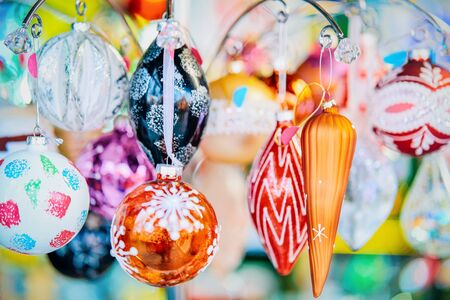 Glass Christmas tree decorations at Christmas market of Germany in Europe in winter. German Night street Xmas and holiday fair in European city or town, December. Berlin in Gendarmenmarkt