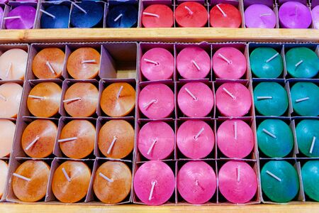 Colorful Handmade Candles at Christmas market in Germany in Europe in winter. German Night street Xmas and holiday fair in European city or town, December. Gendarmenmarkt in Berlin