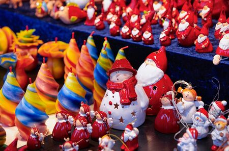 Ceramic Christmas decorations and candle in Christmas market in Germany in Europe in winter. German Night street Xmas and holiday fair in European city or town, December. Gendarmenmarkt in Berlin