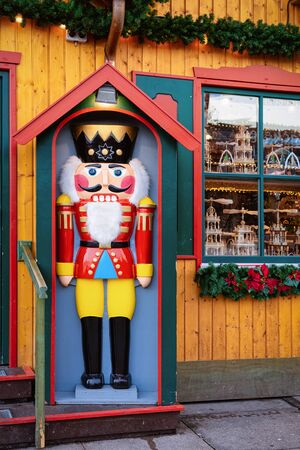 Wooden Christmas nutcracker toy in Christmas market at Germany in Europe in winter. German street Xmas fair in European city or town. Berlin in Alexanderplatz