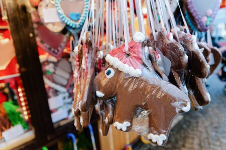 Gingerbread cookies at Christmas market of Germany in Europe in winter. German Night street Xmas and holiday fair in European city or town, December. Gendarmenmarkt in Berlin Stock Photo