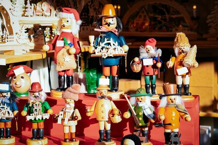 Wooden Christmas toys and decorations in Christmas market at Germany in Europe in winter. German street Xmas fair with wood nutcrackers in European city or town. Berlin on Alexanderplatz