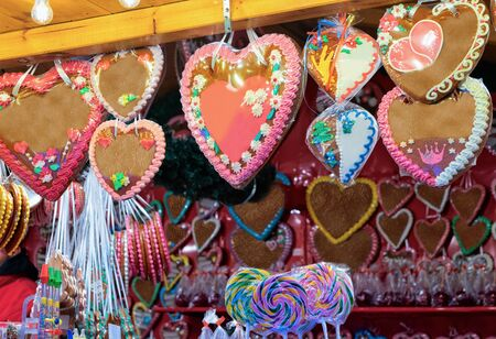 Heart shape Gingerbread cookies of Christmas market of Germany in Europe in winter. German Night street Xmas and holiday fair in European city or town, December. Gendarmenmarkt in Berlin