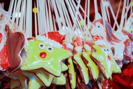 Gingerbread cookies on Christmas market in Germany in Europe in winter. German Night street Xmas and holiday fair in European city or town, December. Alexanderplatz in Berlin