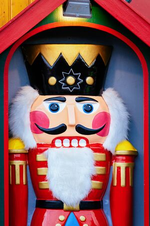 Wooden Christmas nutcracker toy on Christmas market at Germany in Europe in winter. German street Xmas fair in European city or town. Berlin in Alexanderplatz