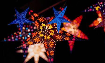 Star as Christmas tree decorations in Christmas market in Germany in Europe in winter. German Night street Xmas and holiday fair in European city or town, December. Gendarmenmarkt in Berlin Archivio Fotografico - 129812920