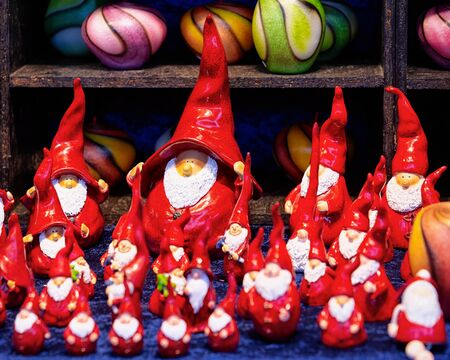 Ceramic Christmas gnome decorations in Christmas market in Germany in Europe in winter. German Night street Xmas and holiday fair in European city or town, December. Gendarmenmarkt in Berlin