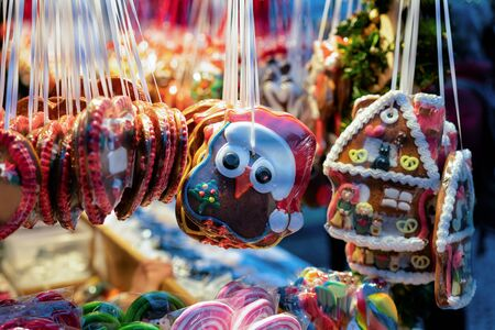 Gingerbread cookies in Christmas market of Germany in Europe in winter. German Night street Xmas and holiday fair in European city or town, December. Gendarmenmarkt in Berlin