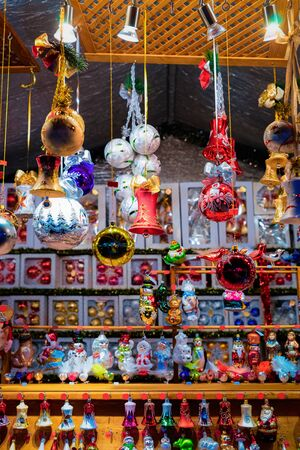 Glass Christmas tree decorations at Christmas market at Germany in Europe in winter. German Night street Xmas and holiday fair in European city or town, December. Berlin on Alexanderplatz