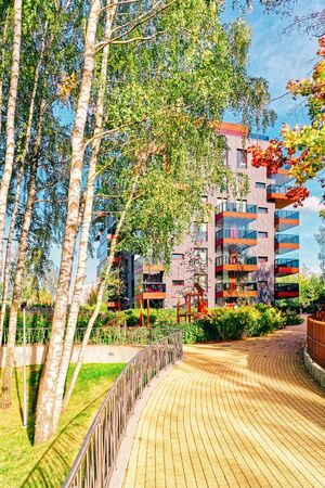Birch trees and Modern glass apartment residential building. And outdoor facilities. Reklamní fotografie