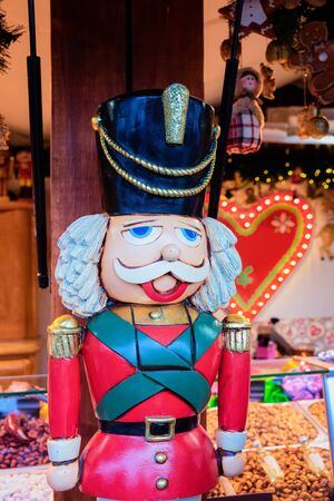 Wooden Christmas nutcracker toy at Christmas market at Germany in Europe in winter. German street Xmas fair in European city or town. Berlin on Alexanderplatz