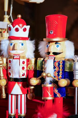 Wooden Christmas toys and decorations at Christmas market at Germany in Europe in winter. German street Xmas fair with wood nutcrackers in European city or town. Berlin at Alexanderplatz Stock Photo