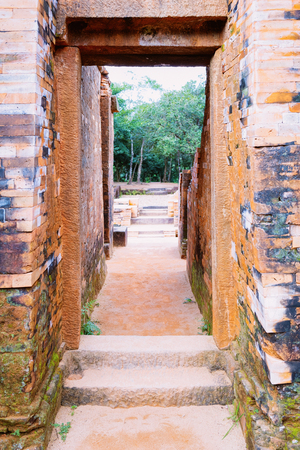 Corridor at My Son Sanctuary and Hindu Temple near Hoi An in Vietnam in Asia. Heritage of Champa Kingdom. Myson History and Culture. Shiva city ruins. Vietnamese Museum. Hinduism Civilization Editorial