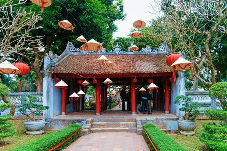 Gate at courtyard at Temple of Literature in Hanoi in Southeast Asia in Vietnam. Temple of Confucius in Vietnamese capital. Street view in park at Asian Church in Ha Noi. Outdoor and architecture.
