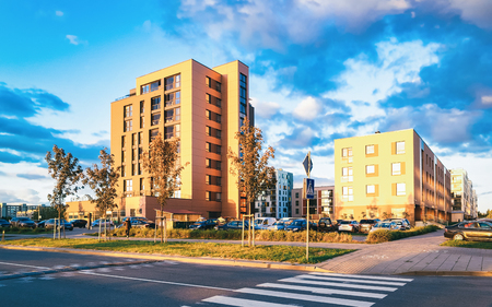 EU Apartment house and home residential building complex real estate concept. And street car parking. During sunset Publikacyjne