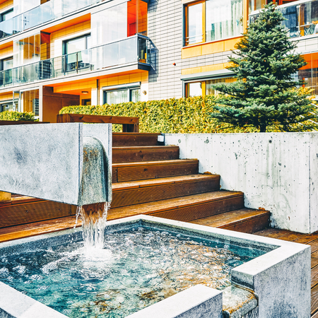 Vilnius, Lithuania - October 1, 2016: Decorative water fountain and Modern complex of apartment residential buildings. With outdoor facilities. Redakční