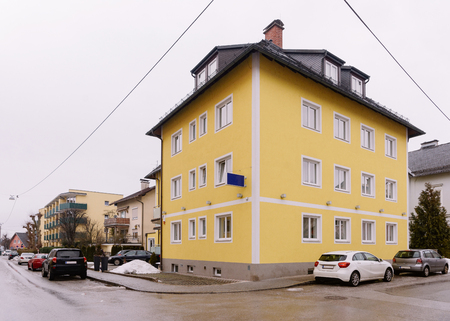 House architecture at Salzburg in Austria. Townhouse real estate and residential building in Austrian city. Redakční