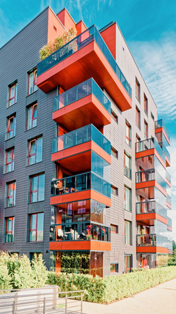 Vilnius, Lithuania - October 1, 2016: Modern glass residential building. And outdoor facilities.