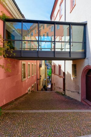 Glass passage between two buildings. Cityscape with Street in Old city of Baden Baden in Baden Wurttemberg in Germany. View of modern passageway house architecture at Bath and spa German town, Europe