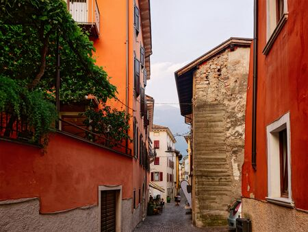Cityscape at Arco town center near Garda lake of Trentino of Italy. Street with house architecture at Old city in Trento near Riva del Garda. Travel and tourism. Evening