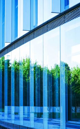 Glass Business office building architecture and Modern City. Urban corporate skyscraper exterior and skyline. Windows design. Blue background. Cityscape with futuristic view concept 版權商用圖片