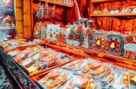 Gingerbreed sweet food stall in Christmas market in Riga in Latvia in winter. Stock Photo