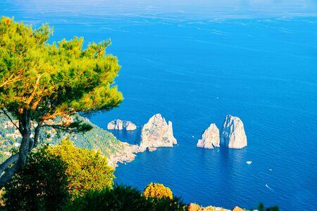 Capri Island and Faraglioni near Naples, Italy. Landscape with Blue Mediterranean Sea at Italian coast. Panorama of Anacapri in Europe. View in summer. Beautiful Amalfi scenery and Solaro mountain