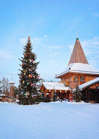 Santa Office and Christmas tree in Santa Claus Village, Rovaniemi, Lapland, Finland, on Arctic Circle in winter. Reklamní fotografie