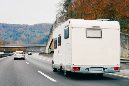 White Camper rv in road on highway Stock fotó