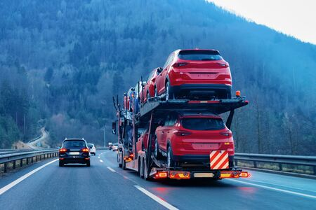 Cars carrier transporter truck on road Auto vehicles