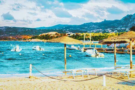 Capriccioli Beach on Blue Waters of the Mediterranean Sea in Costa Smeralda in Sardinia Island in Italy