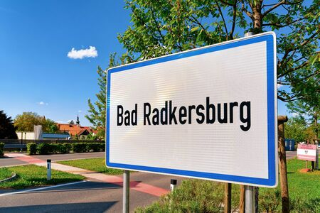 Modern Traffic road sign on white - Bad Radkersburg construction symbol. Design element in Austria. Street information concept. Retro Highway. Transportation board frame. Sky on background Stock fotó - 133499290