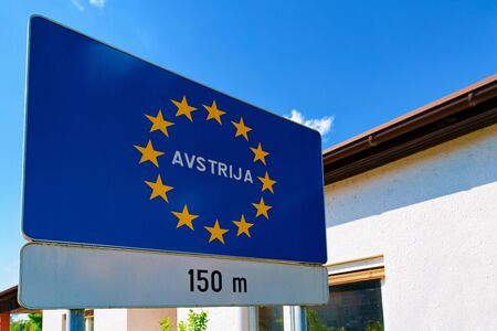 Modern Traffic road sign on blue with EU stars - Avstrija, or Austria construction symbol. Design element. Street information concept. Retro Highway. Transportation board frame. Sky on background Stock fotó - 133499292