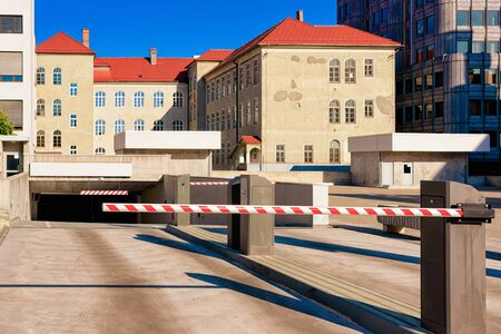 Modern car parking barrier, great design for any purposes. Underground garage in Maribor, Slovenia. Safety concept. Automotive technology for city transport. Free space. Urban Public Street area.