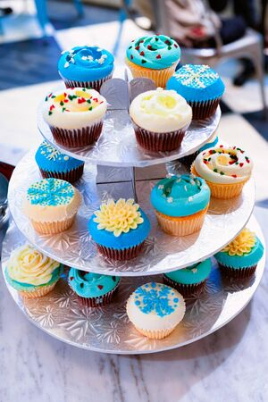 Blue and white cupcakes in a plate
