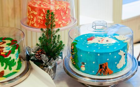 Cake with Santa Claus Christmas decoration on the table.