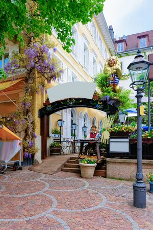 Terrace of street cafe or restaurant at Old city of Baden Baden in Baden Wurttemberg region of Germany. Cityscape view of sqaure at Bath and spa German town in Europe. Landmark in summer. Travel