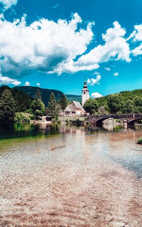 Scenery and Church St John Baptist Bohinj Lake in Slovenia