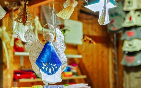 Handmade linen angel hanging at the Riga Christmas market new Archivio Fotografico - 135803009