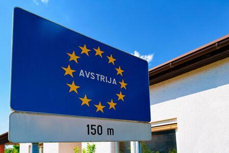 Modern Traffic road sign on blue with EU stars Avstrija Stock fotó