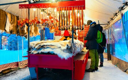 People at Market stall reindeer skin in winter Rovaniemi new Stock Photo