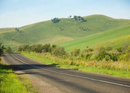 Empty Road and Nature in countryside with green hills