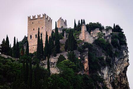 Landscape and Castello di Arco on rock Garda lake evening