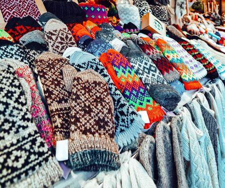 Colorful woolen gloves on Riga Christmas Market reflex