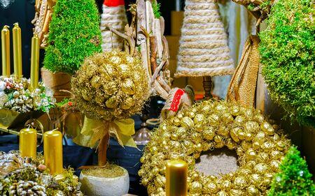 Golden handmade wreaths and souvenirs at Riga Christmas market Stock fotó