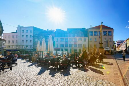 People at street cafe on Castle Square in Maribor